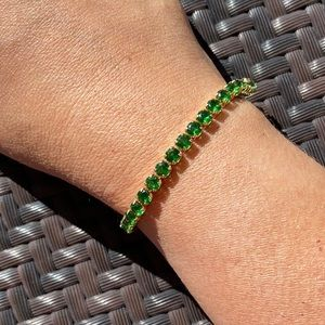 Stunning emerald lab created tennis bracelet